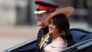Britain's Prince Harry, left, and Meghan, Duchess of Sussex ride in a carriage to attend the annual Trooping the Colour Ceremony in London, Saturday, June 9, 2018.(AP Photo/Frank Augstein)