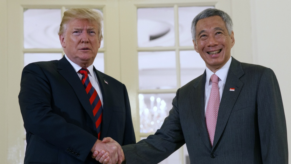 U.S. President Donald Trump shakes hands as he meets with Singapore Prime Minister Lee Hsien Loong ahead of a summit with North Korean leader Kim Jong Un in Singapore on Monday, June 11, 2018. (AP Photo/Evan Vucci)