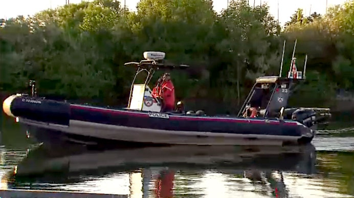 Toronto Police's Marine Unit searches an area near Scarborough Bluffs where a boater reportedly fell out of a boat on June 10, 2018.