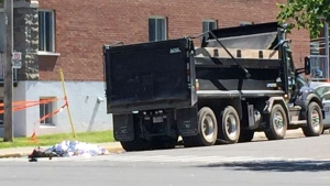 A 30-year-old woman died on Monday June 11, 2018 following a collision with a dump truck (CTV Montreal/Matt Grillo)