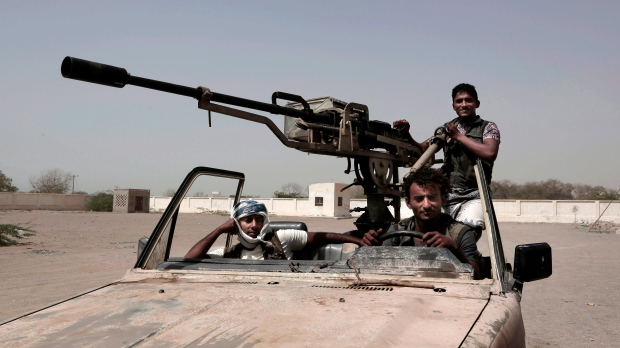Young Saudi-backed forces, part of Ahmed Al-Kawkabani's southern resistance unit in Hodeida, patrol al-Khoukha, Yemen on Feb. 12, 2018. (AP Photo/Nariman El-Mofty)