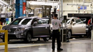 Line workers assemble a Lexus SUV at the Toyota plant in Cambridge, Ont., Friday, July 31, 2015. (THE CANADIAN PRESS/Aaron Lynett)