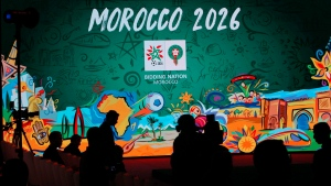 In this Saturday March 17, 2018 file photo, a giant screen display the logo of Morocco 2026 inside of the reception before a press conference to promote Morocco's bib for the 2026 soccer World Cup in Casablanca, Morocco. (AP Photo/Abdeljalil Bounhar)
