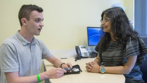 Dr. Kaberi Dasgupta, right, and study participant and co-author Michael Wright, chat about blood sugar testing at the MUHC superhospital in Montreal on Monday, June 11, 2018.THE CANADIAN PRESS/Ryan Remiorz