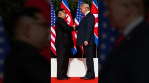 North Korean leader Kim Jong Un, left, and U.S. President Donald Trump shake hands prior to their meeting on Sentosa Island in Singapore Tuesday, June 12, 2018. (AP Photo/Evan Vucci)