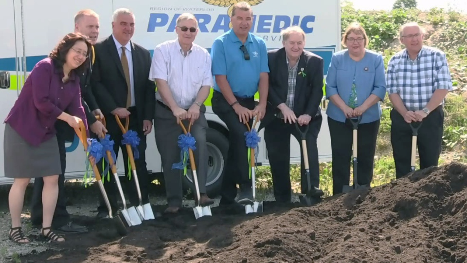 Politicians and other local officials take part in a ceremonial groundbreaking at the site of a future ambulance station on Erbs Road in Waterloo.