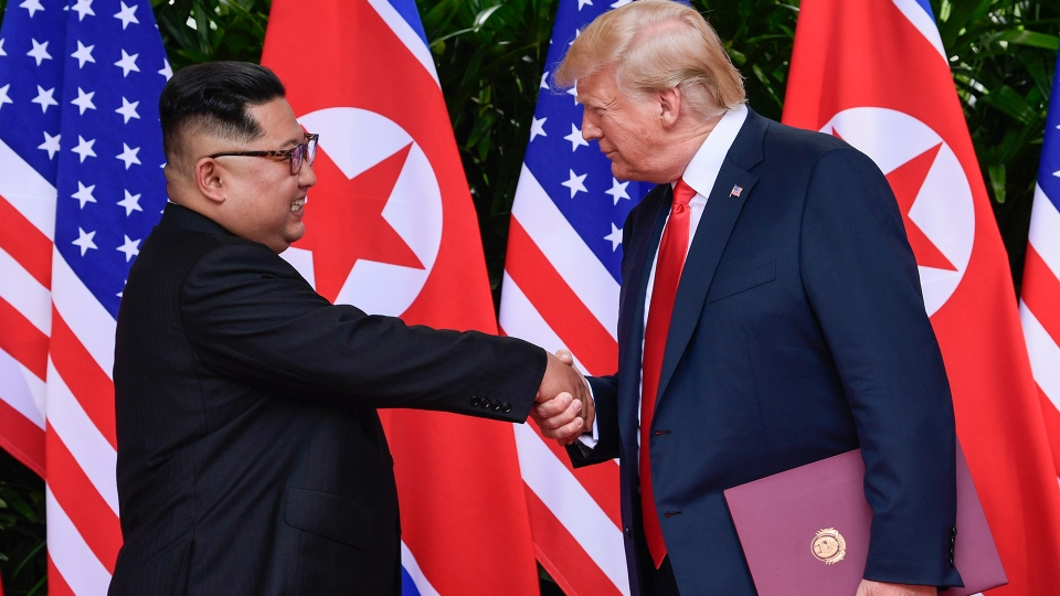 North Korea leader Kim Jong Un and U.S. President Donald Trump shake hands at the conclusion of their meetings at the Capella resort on Sentosa Island Tuesday, June 12, 2018 in Singapore. (AP / Susan Walsh)