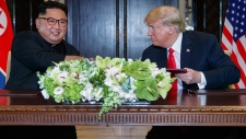 Trump and Kim Jong Un sign document in Singapore