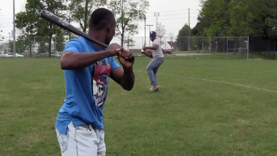 Yunior Yambatis prepares to take a swing against Yomar Concepcion. Both players from La Cabana, Dominican Republic, are spending the summer with the Guelph Royals.