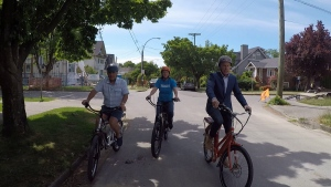Ross McLaughlin test rides an electric bike with Greg Wong and Ann MacLennan. (CTV)