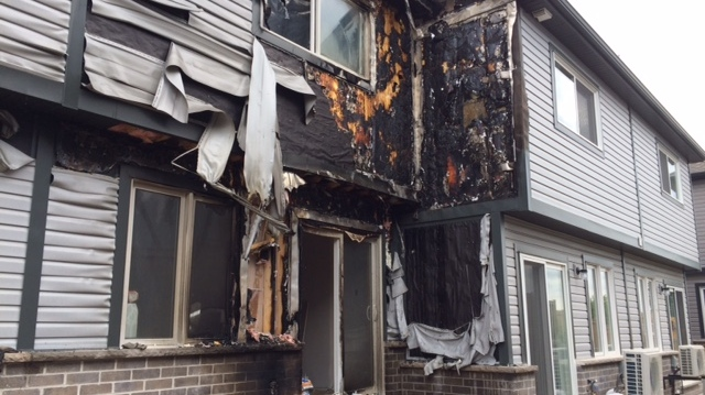 Fire caused significant damage to a townhouse on Dundas Street South in Cambridge on Tuesday, June 12, 2018. (David Pettitt / CTV Kitchener)