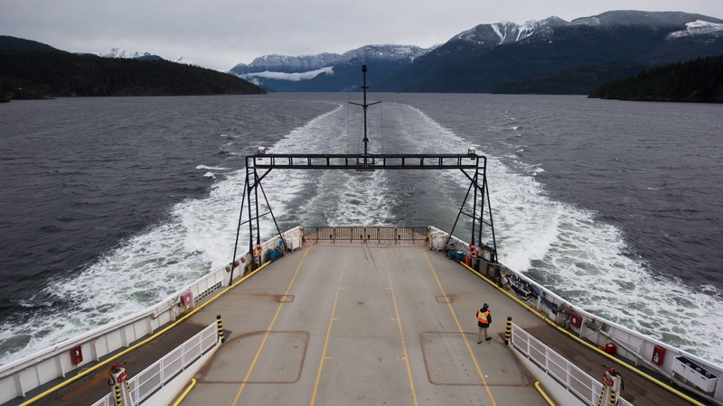 A crew member walks on the vehicle deck of the BC Ferries' vessel Island Sky while travelling on the waters off the Sunshine Coast, from Saltery Bay to Earls Cove, B.C., on Friday March 17, 2017. THE CANADIAN PRESS/Darryl Dyck