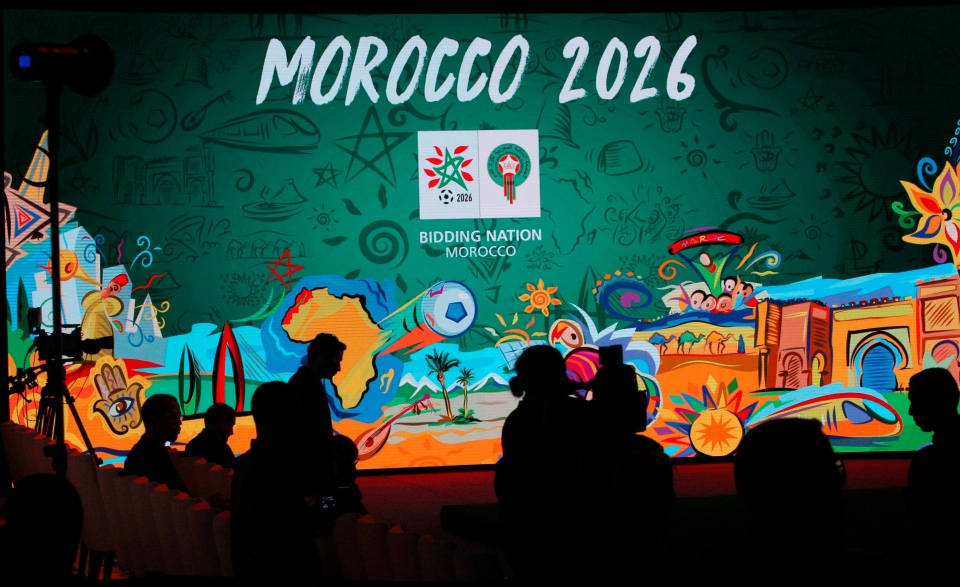 In this Saturday March 17, 2018 file photo, a giant screen displays the logo of Morocco 2026 before a press conference to promote Morocco's bid for the 2026 soccer World Cup in Casablanca, Morocco. (AP Photo/Abdeljalil Bounhar)
