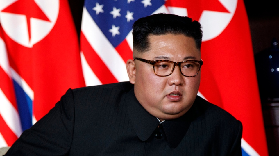 North Korean leader Kim Jong Un listens to U.S. President Donald Trump during a meeting on Sentosa Island in Singapore Tuesday, June 12, 2018. (AP Photo/Evan Vucci)