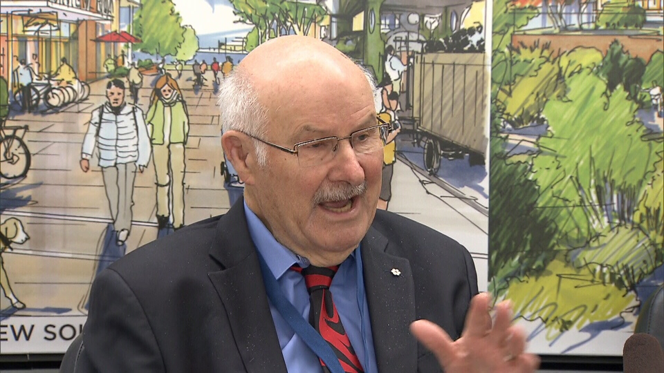 Former NDP premier Mike Harcourt speaks to reporters on Tuesday, June 12, 2018.