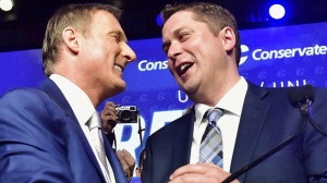 Andrew Scheer, right, is congratulated by Maxime Bernier after being elected the new leader of the federal Conservative party at the federal Conservative leadership convention in Toronto on Saturday, May 27, 2017. THE CANADIAN PRESS/Frank Gunn