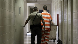 An inmate at the Madera County Jail is taken to a housing unit at the facility in Madera, Calif. on Feb. 21, 2013. (AP Photo/Rich Pedroncelli)