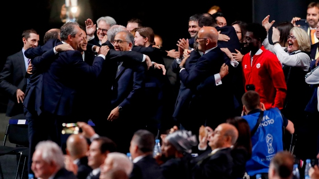Delegates of Canada, Mexico and the United States celebrate after winning a joint bid to host the 2026 World Cup at the FIFA congress in Moscow, Russia, Wednesday, June 13, 2018. (AP / Pavel Golovkin)