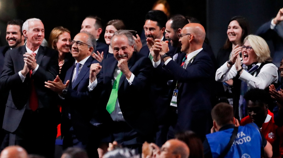 Delegates of Canada, Mexico and the United States celebrate after winning a joint bid to host the 2026 World Cup at the FIFA congress in Moscow, Russia, Wednesday, June 13, 2018. Standing on front row from left: Steve Reed, president of the Canadian Soccer Association, Carlos Cordeiro, U.S. soccer president and Decio de Maria, President of the Football Association of Mexico. (AP Photo/Pavel Golovkin)