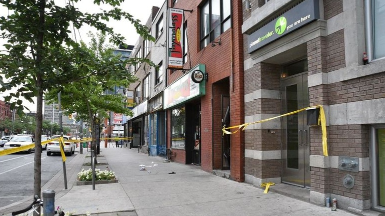 "Toronto police crime scene photos show the exterior of an after-hours club known in 2016 as ""Retox"" where two people were shot dead on Canada Day weekend."
