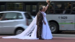 Husband and wife Ademir Avelino, 52, and Glaucia Sudan, 45, pose in wedding clothes for pictures in Sao Paulo. (© Johannes MYBURGH / AFPTV / AFP)