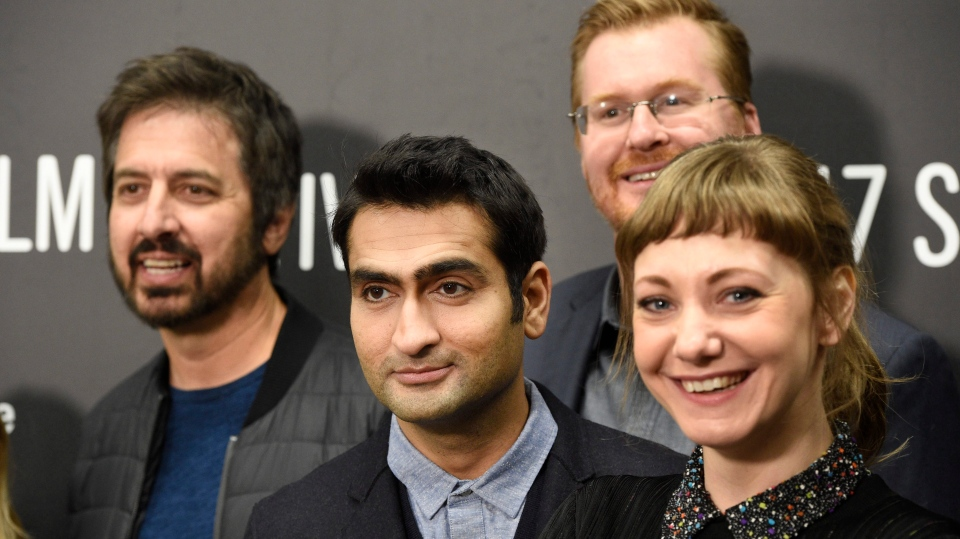 "Kumail Nanjiani, second from left, co-writer and star of ""The Big Sick,"" and his wife and co-writer Emily Gordon, right, pose with cast members Ray Romano, left, and Kurt Braunohler. (Photo by Chris Pizzello/Invision/AP)"