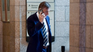 Conservative MP Maxime Bernier talks on his phone as he leaves a caucus meeting on Parliament Hill in Ottawa on Wednesday, June 13, 2018. THE CANADIAN PRESS/Justin Tang