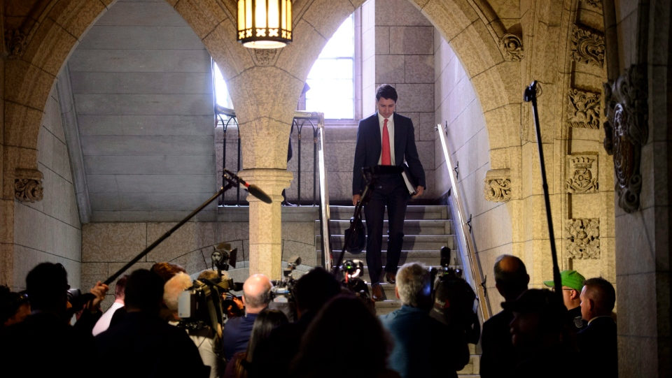 Prime Minister Justin Trudeau makes his way to the House of Commons for question period on Parliament Hill in Ottawa on Wednesday, June 13, 2018. THE CANADIAN PRESS/Sean Kilpatrick