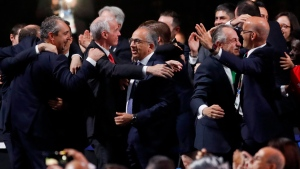 Carlos Cordeiro, U.S. soccer president Delegates of Canada, center, hugs Steve Reed, president of the Canadian Soccer Association, second left, after the United bid from Canada, Mexico and the United States won the vote to host the 2026 World Cup during the FIFA congress in Moscow, Russia, Wednesday, June 13, 2018. (AP / Pavel Golovkin)