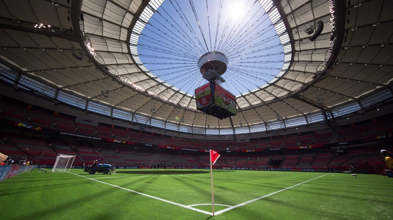 Water is sprayed on the artificial turf before Switzerland and Ecuador play a FIFA Women's World Cup soccer match at B.C. Place stadium in Vancouver, B.C., on June 12, 2015. (THE CANADIAN PRESS/Darryl Dyck)