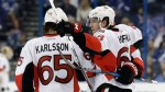 Ottawa Senators left wing Mike Hoffman (68) celebrates with defenseman Erik Karlsson (65), of Sweden, after scoring against the Tampa Bay Lightning during the third period of an NHL hockey game Thursday, Feb. 2, 2017, in Tampa, Fla. The Senators won 5-2. (AP Photo/Chris O'Meara)
