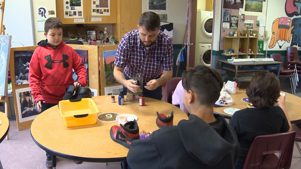 Zac Vine teaching his Sooke students how to paint shoes. June 12, 2018. (CTV Vancouver Island)