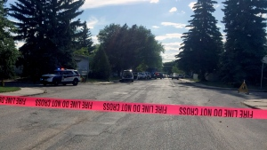 Emergency tape blocks off a street in Saskatoon's Holliston area as police and fire crews respond to an incident involving a man barricaded inside a home Wednesday, June 13, 2018. (Laura Woodward/CTV Saskatoon)