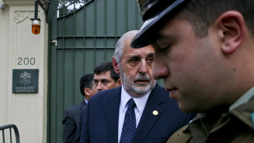 Chile's General Attorney Jorge Abbott, centre, leaves the Apostolic Nunciature after meeting with Archbishop Charles Scicluna in Santiago, Chile, Wednesday, June 13, 2018. AP Photo/Esteban Felix)
