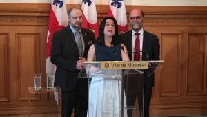 Mayor Valerie Plante introduces Serge Lamontagne, right, as the new City Manager for Montreal on June 14, 2018 (CTV Montreal/Kelly Greig)