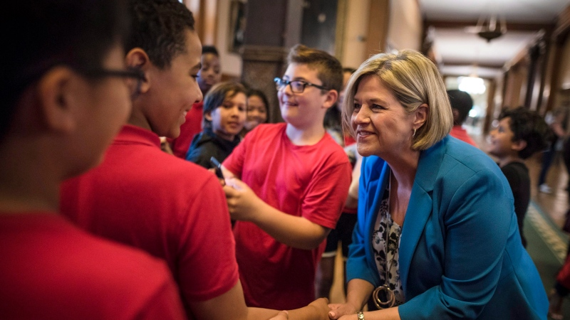 Ontario NDP leader and the leader of the official opposition Andrea Horwath shakes hands with students from St. Joseph Richmond Hill Catholic Elementary School at Queen's Park in Toronto on Friday, June 8, 2018. (THE CANADIAN PRESS/Tijana Martin)