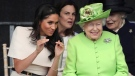 Britain's Queen Elizabeth and Meghan, the Duchess of Sussex, left, attend the opening of the new Mersey Gateway Bridge, in Widnes, north west England, Thursday June 14, 2018. (Danny Lawson/PA via AP)