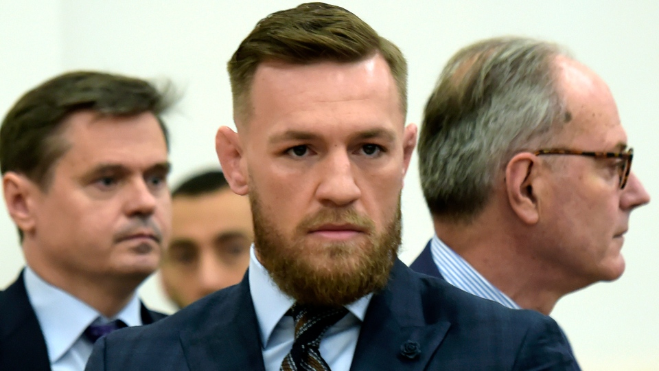 Mixed martial arts fighter Conor McGregor, centre, arrives at Brooklyn Supreme Court, Thursday, June 14, 2018, in New York. (Rashid Umar Abbasi / New York Post)