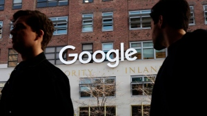 People walk by Google offices in New York on Dec. 4, 2017. (AP Photo/Mark Lennihan)
