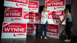 Staff members prepare for Premier Kathleen Wynne's election night event at York Mills Gallery in Toronto on Thursday, June 7, 2018. (THE CANADIAN PRESS/ Tijana Martin)