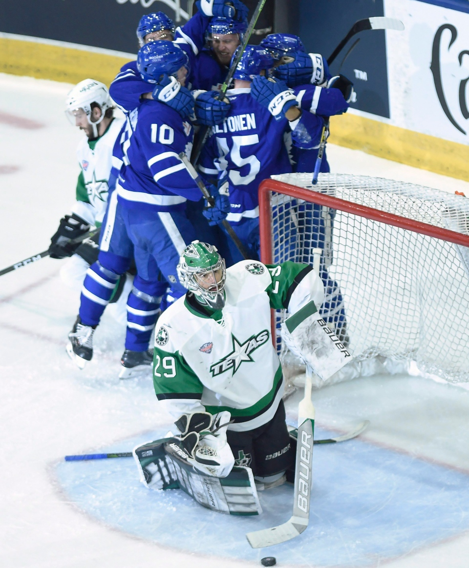 Texas Stars goaltender Mike McKenna (29) moves the puck from his net as the Toronto Marlies celebrate a goal by Andreas Johnsson during first period AHL Calder Cup playoff action in Toronto on Thursday June 14, 2018. (THE CANADIAN PRESS/ Nathan Denette)