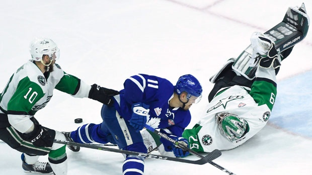 Texas Stars goaltender Mike McKenna (29) poke checks the puck away from Toronto Marlies left wing Andreas Johnsson (11) as Stars centre Justin Dowling (10) defends during third period AHL Calder Cup playoff action in Toronto on Thursday June 14, 2018. THE CANADIAN PRESS/ Nathan Denette