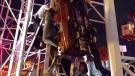 Daytona Beach Firefighters working to free two riders dangling in a roller coaster car. (Twitter/DaytonaBeachFD)