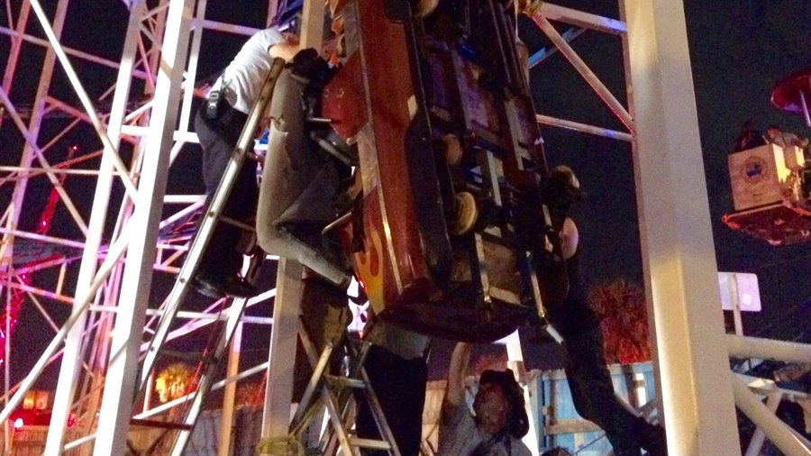 Daytona Beach Firefighters working to free two riders dangling in a roller coaster car. (Twitter/DaytonaBeachFD)