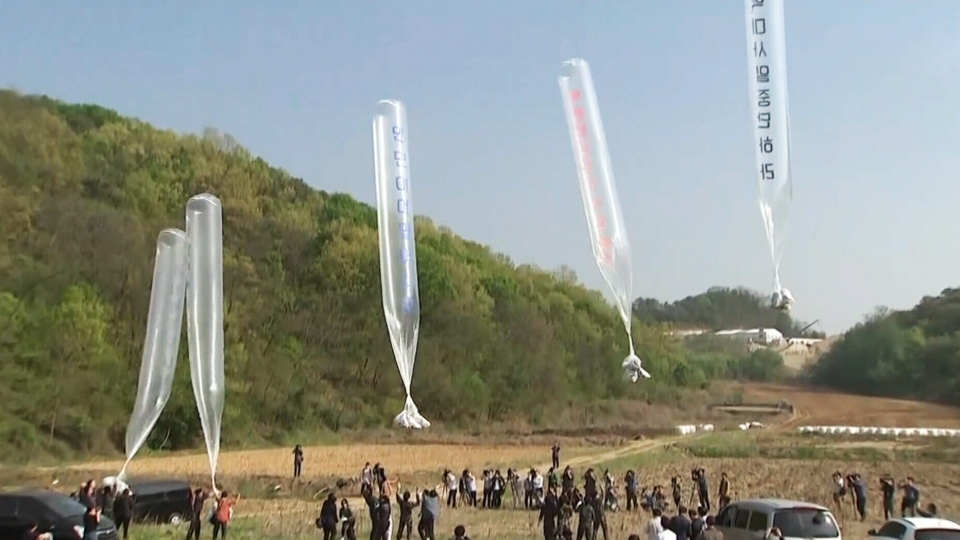 Balloons carrying propaganda leaflets take off from South Korea for its northern neighbour. (CTV News)