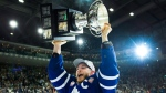 Toronto Marlies right wing Ben Smith (18) hoists the AHL Calder Cup after defeating the Texas Stars in Toronto on Thursday, June 14, 2018. THE CANADIAN PRESS/Nathan Denette
