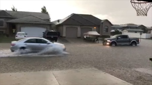 A street in Warman is flooded after a storm on June 14, 2018. (CREDIT: JENNIFER JELLICOE)