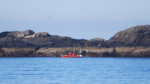 A rescue craft searches the water off Chesterman Beach in Tofino, B.C. (Twitter/@MerlinYYC)