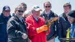 Agriculture Minister Lawrence MacAulay, left, and U.S. Secretary of Agriculture Sonny Perdue go lobster fishing in the North Atlantic off the coast of Cardigan, P.E.I. on Friday, June 15, 2018. (THE CANADIAN PRESS/Andrew Vaughan)