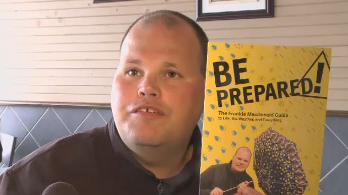 Frankie MacDonald poses with his new book in Sydney on June 14, 2018.